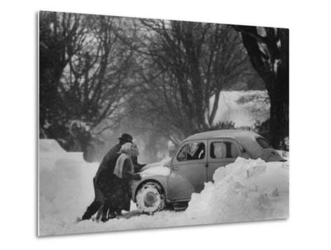 People Trying to Push a Snowbound Car--Metal Print