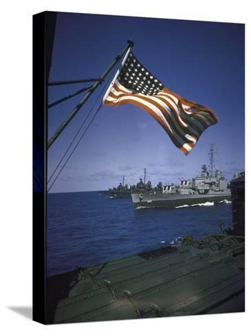 American Flag Flying over Us Navy Ships at Sea--Stretched Canvas Print