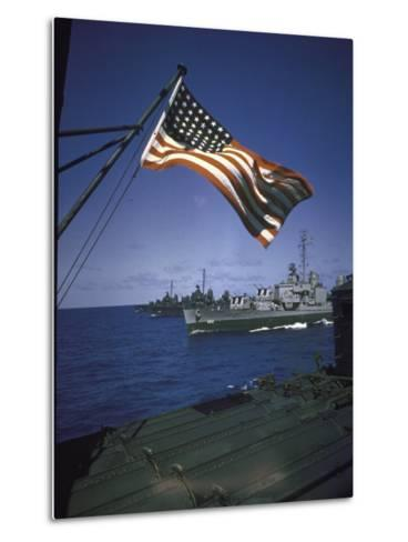 American Flag Flying over Us Navy Ships at Sea--Metal Print