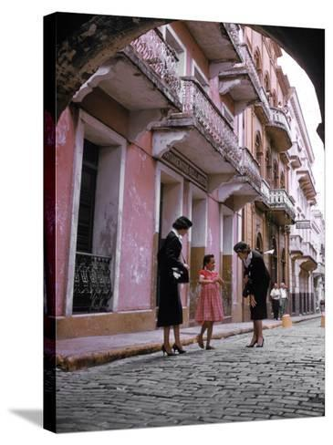 Two Eastern Airlines Stewardesses Talking to Native Girl on Street--Stretched Canvas Print