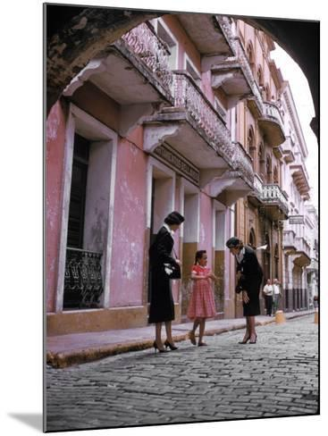 Two Eastern Airlines Stewardesses Talking to Native Girl on Street--Mounted Photographic Print