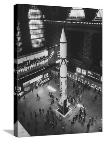 Rocket Being Displayed at Grand Central Station as a Salute to International Geophysical Year--Stretched Canvas Print