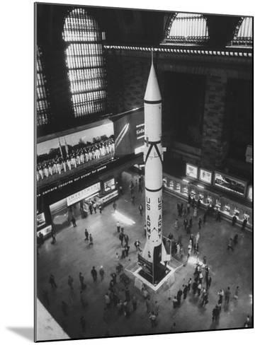 Rocket Being Displayed at Grand Central Station as a Salute to International Geophysical Year--Mounted Photographic Print