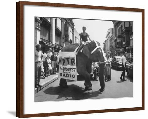 Girl Riding Elephant as a Publicity Stunt for a Radio Station-Peter Stackpole-Framed Art Print