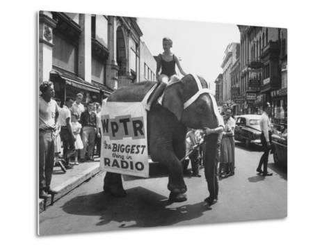 Girl Riding Elephant as a Publicity Stunt for a Radio Station-Peter Stackpole-Metal Print