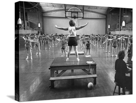 Calisthenics in the Davenport High School Gym-Yale Joel-Stretched Canvas Print