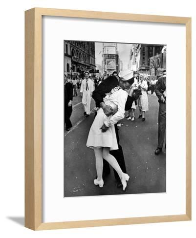 American Sailor Clutching a White-Uniformed Nurse in a Passionate Kiss in Times Square-Alfred Eisenstaedt-Framed Art Print