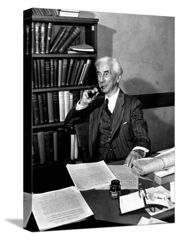 Bertrand Russell Sitting at His Desk at California University at Los Angeles-Peter Stackpole-Stretched Canvas Print