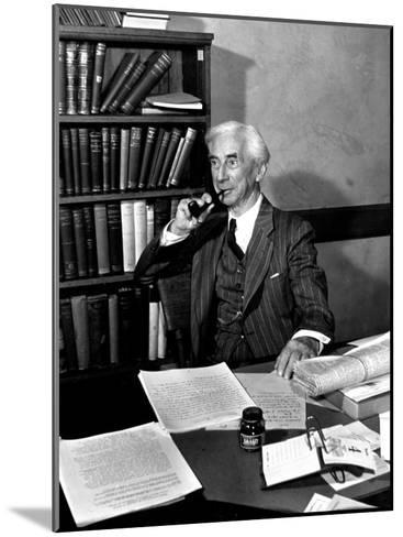 Bertrand Russell Sitting at His Desk at California University at Los Angeles-Peter Stackpole-Mounted Photographic Print