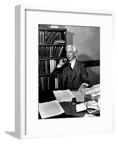 Bertrand Russell Sitting at His Desk at California University at Los Angeles-Peter Stackpole-Framed Art Print