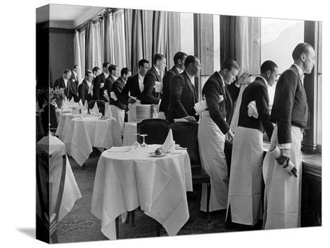 Waiters in the Grand Hotel Dining Room Lined Up at Window Watching Sonia Henie Ice Skating Outside-Alfred Eisenstaedt-Stretched Canvas Print