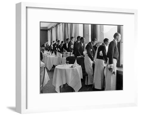 Waiters in the Grand Hotel Dining Room Lined Up at Window Watching Sonia Henie Ice Skating Outside-Alfred Eisenstaedt-Framed Art Print