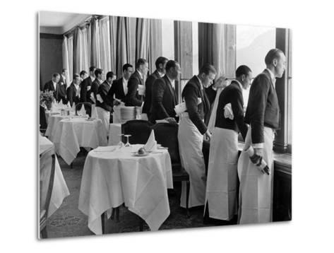 Waiters in the Grand Hotel Dining Room Lined Up at Window Watching Sonia Henie Ice Skating Outside-Alfred Eisenstaedt-Metal Print