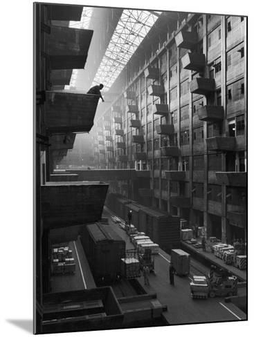 At Brooklyn Army Base Freight Is Lifted from Car to Jutting Loading Platforms-Andreas Feininger-Mounted Photographic Print