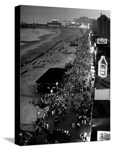 Aerial at Dusk of Beach, Boardwalk and Pier of Resort and Convention City-Alfred Eisenstaedt-Stretched Canvas Print