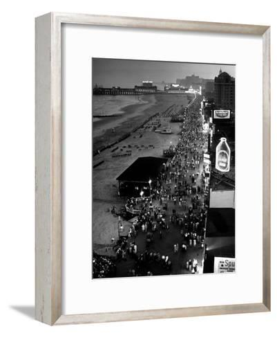 Aerial at Dusk of Beach, Boardwalk and Pier of Resort and Convention City-Alfred Eisenstaedt-Framed Art Print