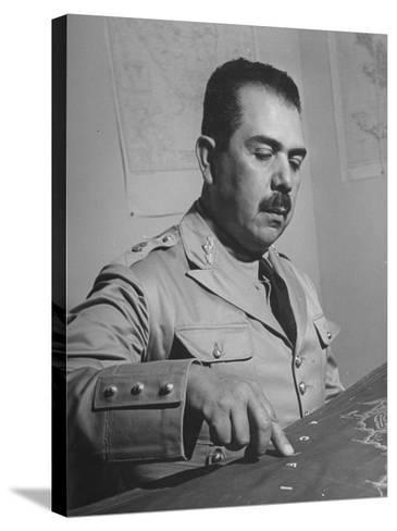 General Lazaro Cardenas, Pointing to a Map as His Continues to Work on a Stradegy-Peter Stackpole-Stretched Canvas Print