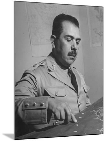 General Lazaro Cardenas, Pointing to a Map as His Continues to Work on a Stradegy-Peter Stackpole-Mounted Photographic Print