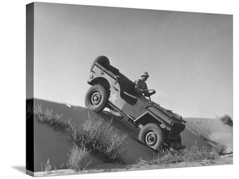 US Army Jeep Rolling Down a Sand Dune During Training Maneuvers in the Desert--Stretched Canvas Print