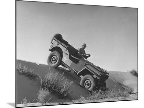 US Army Jeep Rolling Down a Sand Dune During Training Maneuvers in the Desert--Mounted Photographic Print