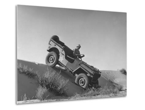 US Army Jeep Rolling Down a Sand Dune During Training Maneuvers in the Desert--Metal Print