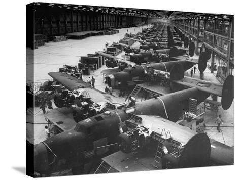 Men Working on Consolidated Aircrafts-Dmitri Kessel-Stretched Canvas Print