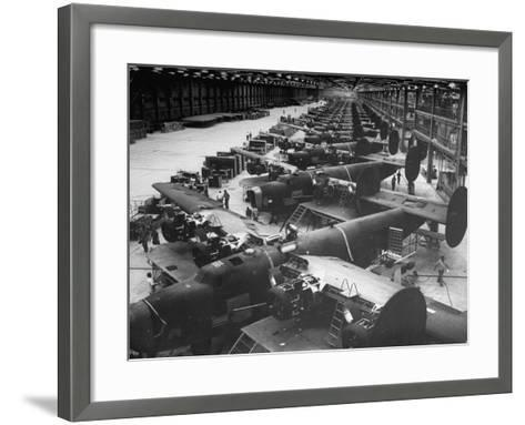 Men Working on Consolidated Aircrafts-Dmitri Kessel-Framed Art Print