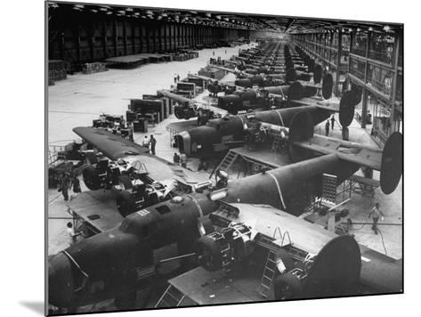 Men Working on Consolidated Aircrafts-Dmitri Kessel-Mounted Photographic Print