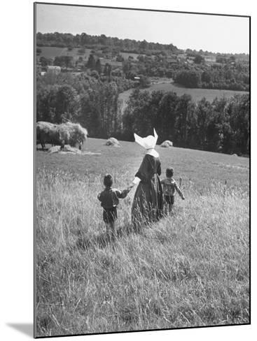 Nun Taking Two Young Children from the Mission on a Walk--Mounted Photographic Print