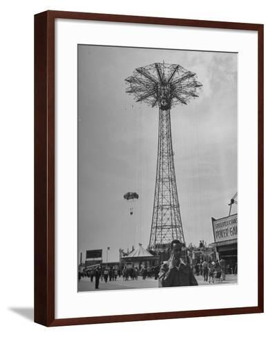 People Enjoying a Ride at Coney Island Amusement Park-Ed Clark-Framed Art Print