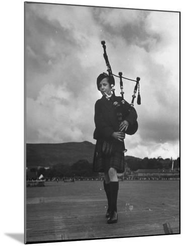 Twelve Year Old Boy Winning First Prize in Both of the Piping Contests Open to Him at Cowal--Mounted Photographic Print