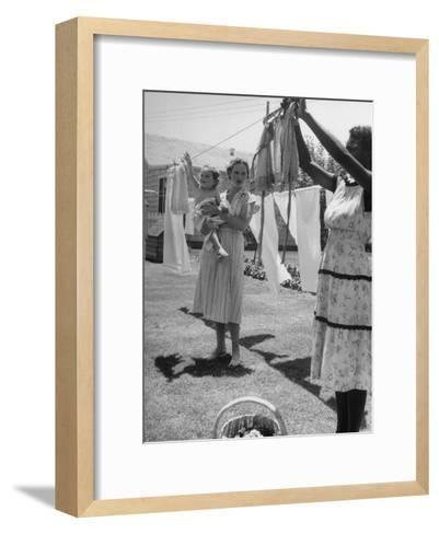 Woman Hanging the Laundry Out to Dry-Nina Leen-Framed Art Print