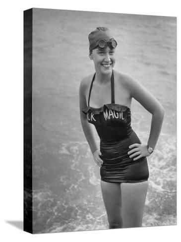 "Swimmer Shirley May France, Standing in the Ocean Wearing Her ""Black Magic"" Swimsuit--Stretched Canvas Print"