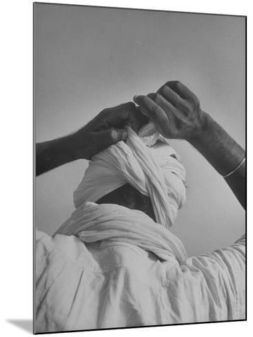 Sikh Man Demonstrating How He Finishes the Winding of His Traditional Turban around His Head-Margaret Bourke-White-Mounted Photographic Print