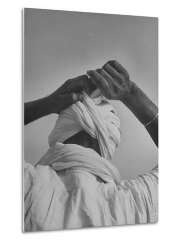 Sikh Man Demonstrating How He Finishes the Winding of His Traditional Turban around His Head-Margaret Bourke-White-Metal Print