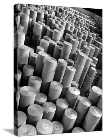 Rolls of Kraft Paper to Be Made into Paper Sacks Sit Stacked in the Union Bag and Paper Corp. Plant-Margaret Bourke-White-Stretched Canvas Print