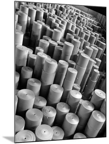 Rolls of Kraft Paper to Be Made into Paper Sacks Sit Stacked in the Union Bag and Paper Corp. Plant-Margaret Bourke-White-Mounted Photographic Print