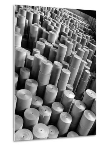 Rolls of Kraft Paper to Be Made into Paper Sacks Sit Stacked in the Union Bag and Paper Corp. Plant-Margaret Bourke-White-Metal Print