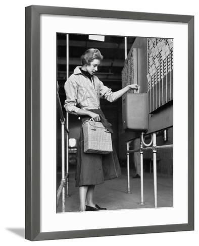 Young Lady Modeling New Line of Clothing While Getting Her Time Card Punched-Yale Joel-Framed Art Print