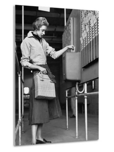 Young Lady Modeling New Line of Clothing While Getting Her Time Card Punched-Yale Joel-Metal Print