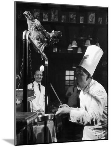 French Restaurant Owner Sam Letrone Entertaining Patrons with His Performing Chicken-Loomis Dean-Mounted Photographic Print