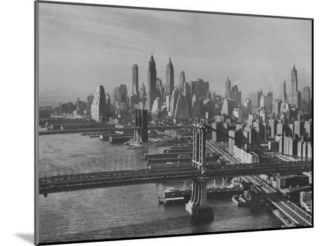 New York City Behind the Brooklyn and Manhattan Bridges That are Hovering over the East River-Dmitri Kessel-Mounted Photographic Print