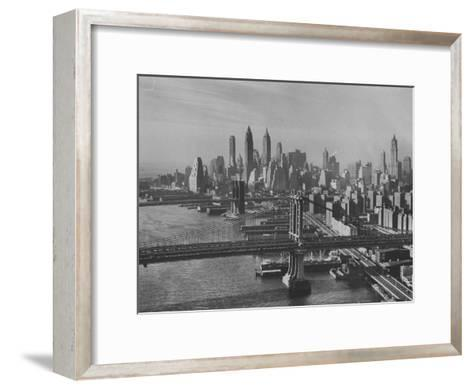 New York City Behind the Brooklyn and Manhattan Bridges That are Hovering over the East River-Dmitri Kessel-Framed Art Print