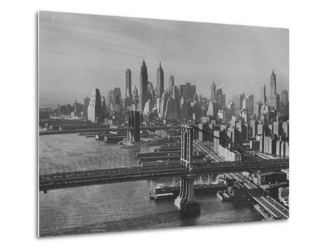 New York City Behind the Brooklyn and Manhattan Bridges That are Hovering over the East River-Dmitri Kessel-Metal Print
