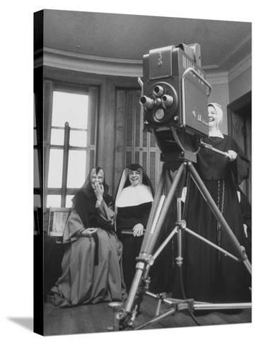 Two Nuns Smiling from the Wings While the Third Is Operating the Large TV Camera--Stretched Canvas Print