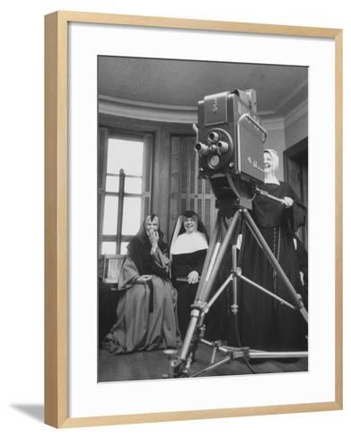 Two Nuns Smiling from the Wings While the Third Is Operating the Large TV Camera--Framed Art Print