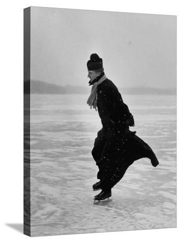 Catholic Priest Ice Skating. from Photo Essay Re Polish American Community-John Dominis-Stretched Canvas Print