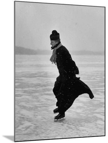 Catholic Priest Ice Skating. from Photo Essay Re Polish American Community-John Dominis-Mounted Photographic Print