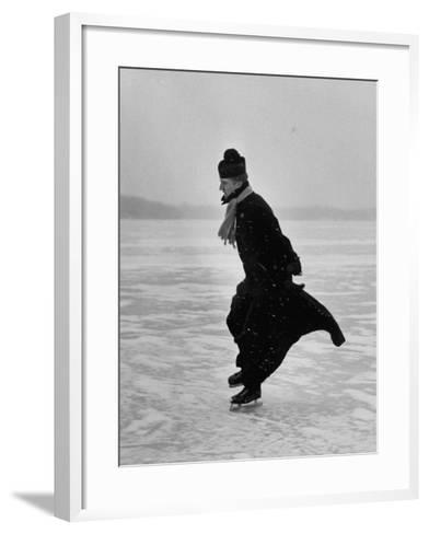 Catholic Priest Ice Skating. from Photo Essay Re Polish American Community-John Dominis-Framed Art Print