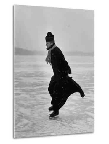 Catholic Priest Ice Skating. from Photo Essay Re Polish American Community-John Dominis-Metal Print